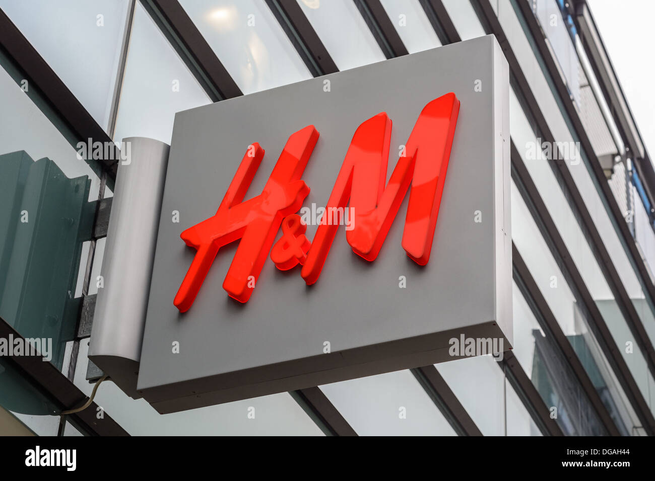 Red illuminated H&M company logo sign of H & M Hennes & Mauritz AB, a Swedish multinational retail-clothing fast Stock Photo