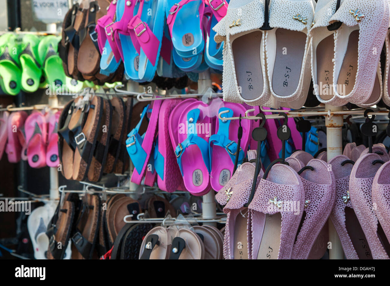 Shop selling colourful sandals, thongs and flip-flops in seaside resort along the coast - Stock Image
