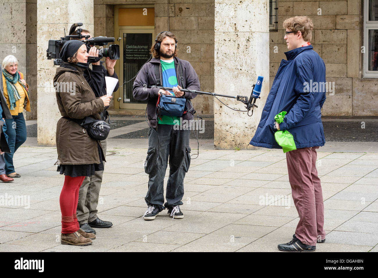 German television camera crew (ARD, WDR) interviewing a young Caucasian man on the street – Königstraße Stuttgart Stock Photo