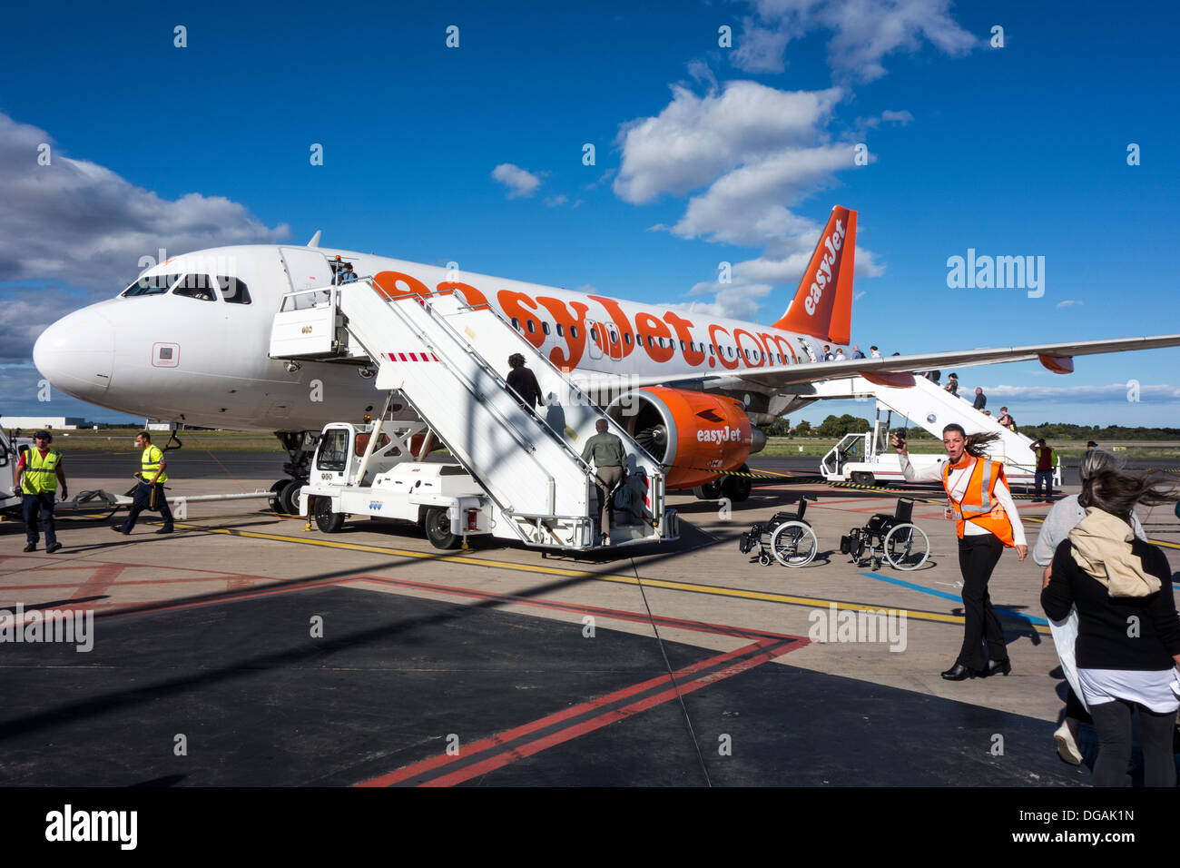 passengers board Easyjet airline plane on tarmac runway of Montpellier airport; Herault; Languedoc Roussillon  France - Stock Image