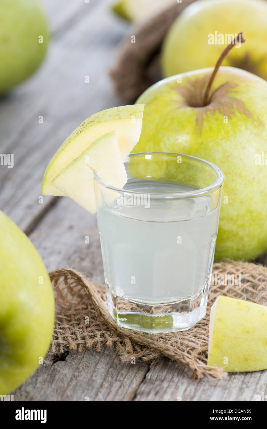 Shots of Apple Liqueur on vintage background - Stock Image