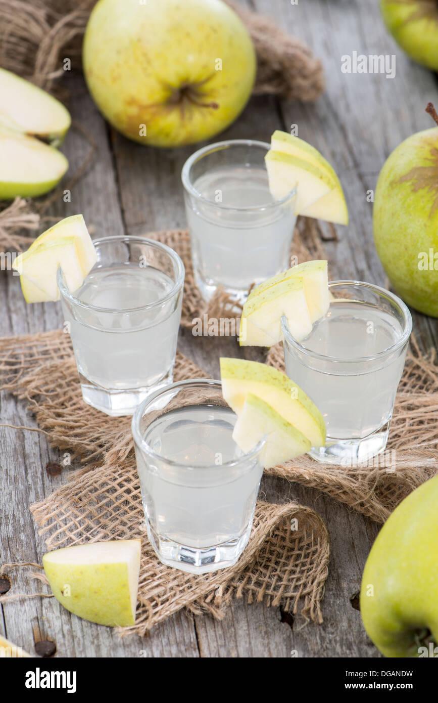 Apple Liqueur Shots on wooden background - Stock Image