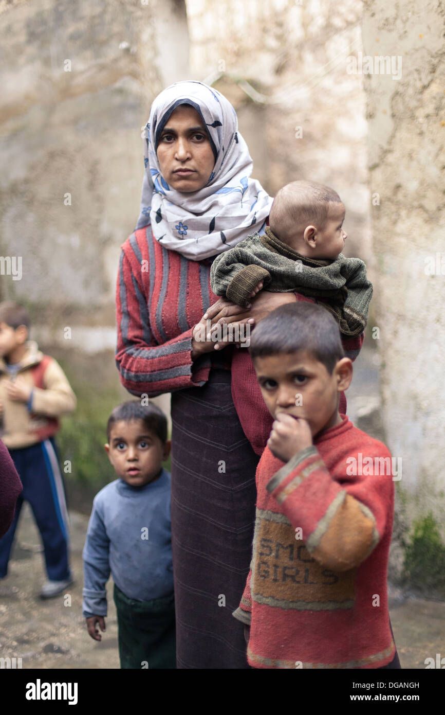 11/02/13 Aleppo, Syria. A mother and her three children in Aleppo. - Stock Image