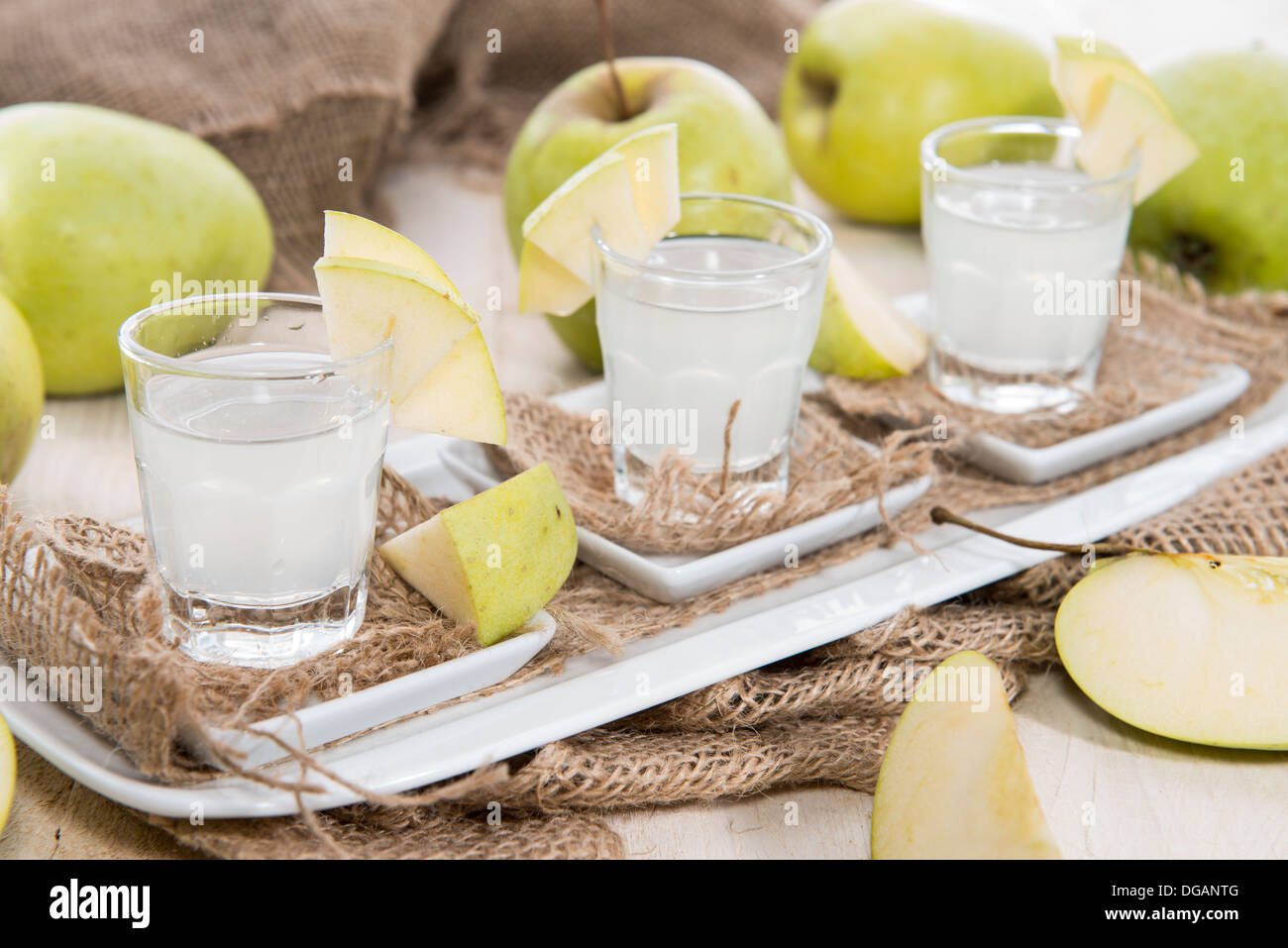Shots of Apple Liqueur on vintage background - Stock Image