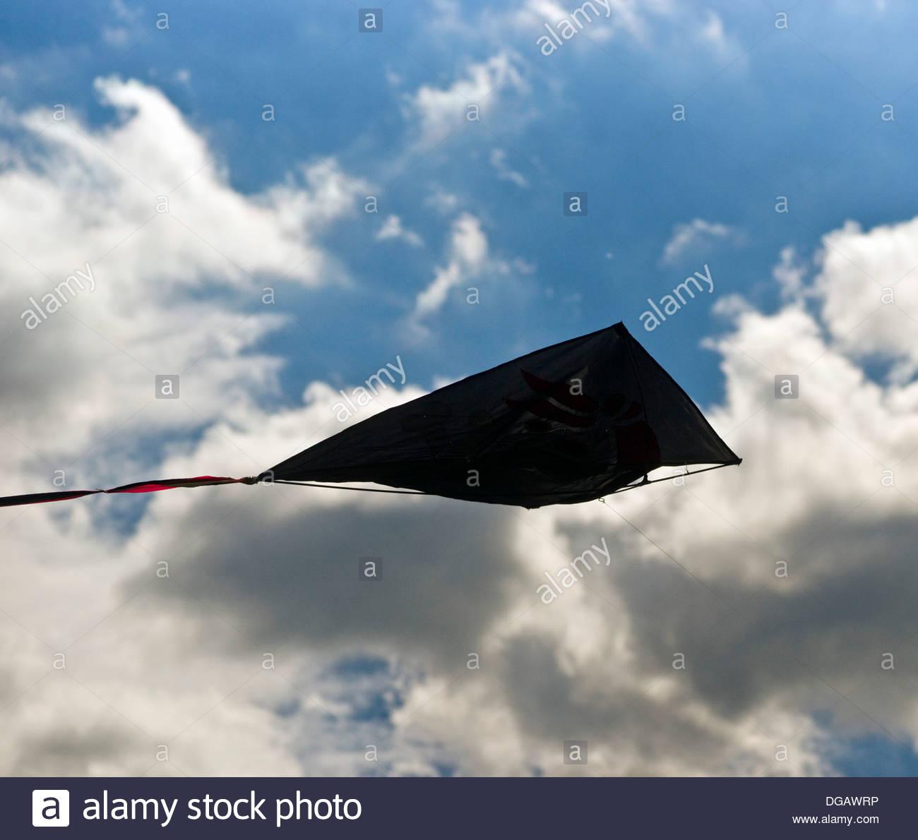 flying kite kites child boy children kid kids - Stock Image