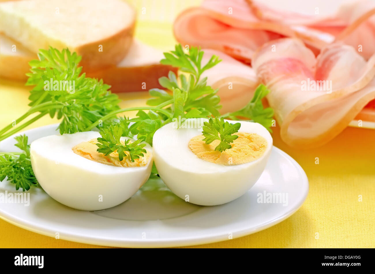 Breakfast with eggs and bacon on white plate - Stock Image