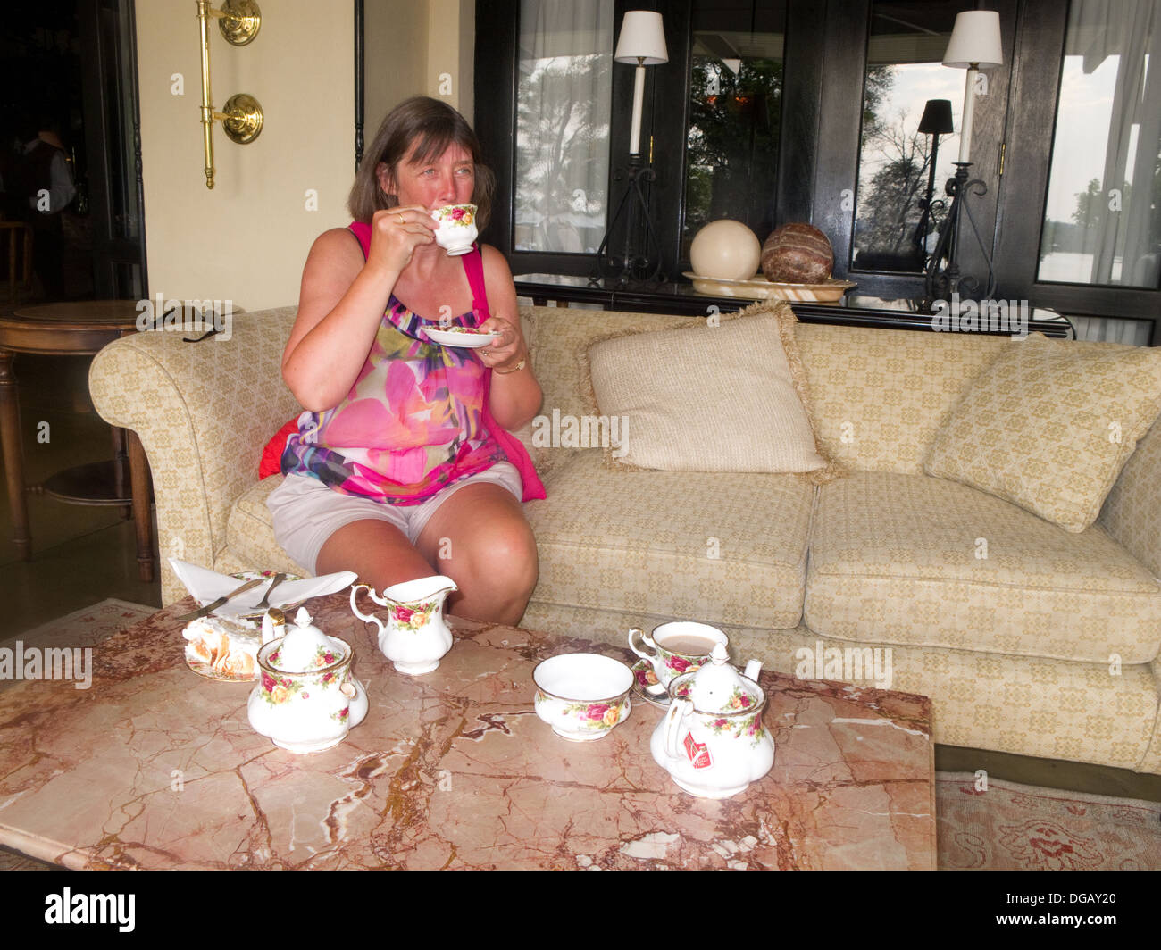 A guest having high tea, the Royal Livingstone Hotel, Victoria Falls, Zambia Africa - Stock Image