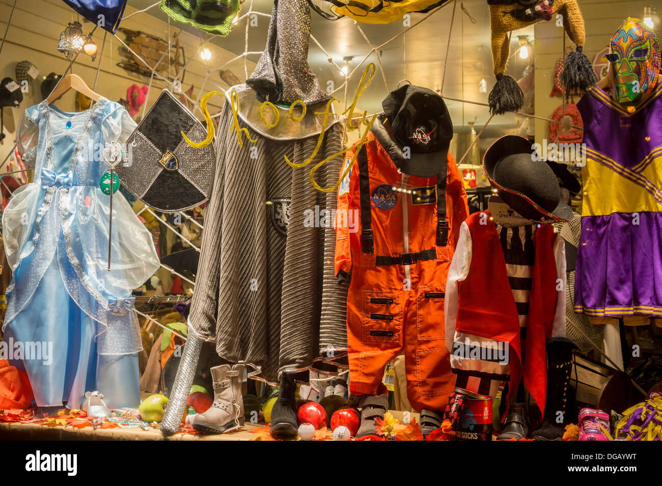 halloween costumes and merchandise in the window of a children's