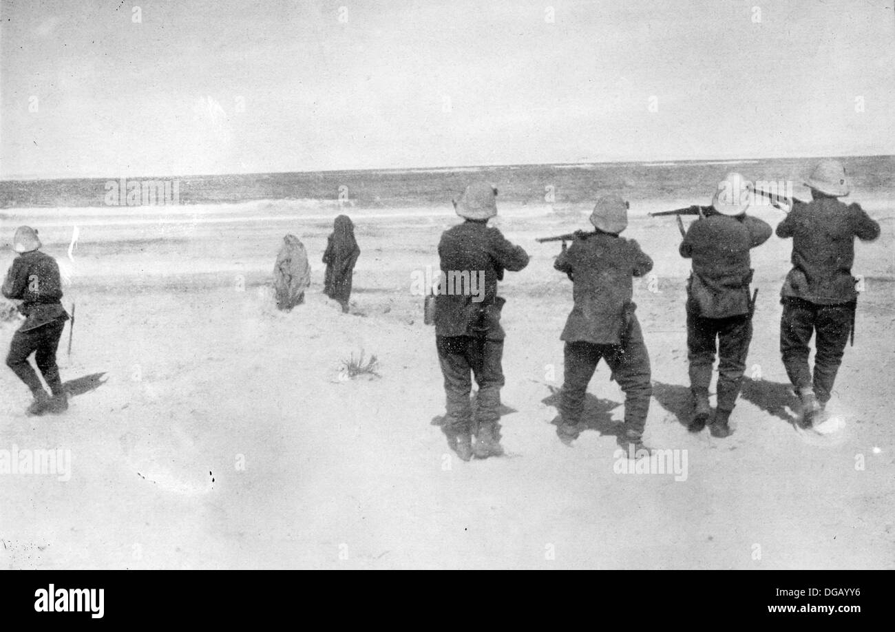 Execution of two Arab spies in Tripoli Italian soldiers executing Arabs on a beach during the Turco-Italian War - Stock Image