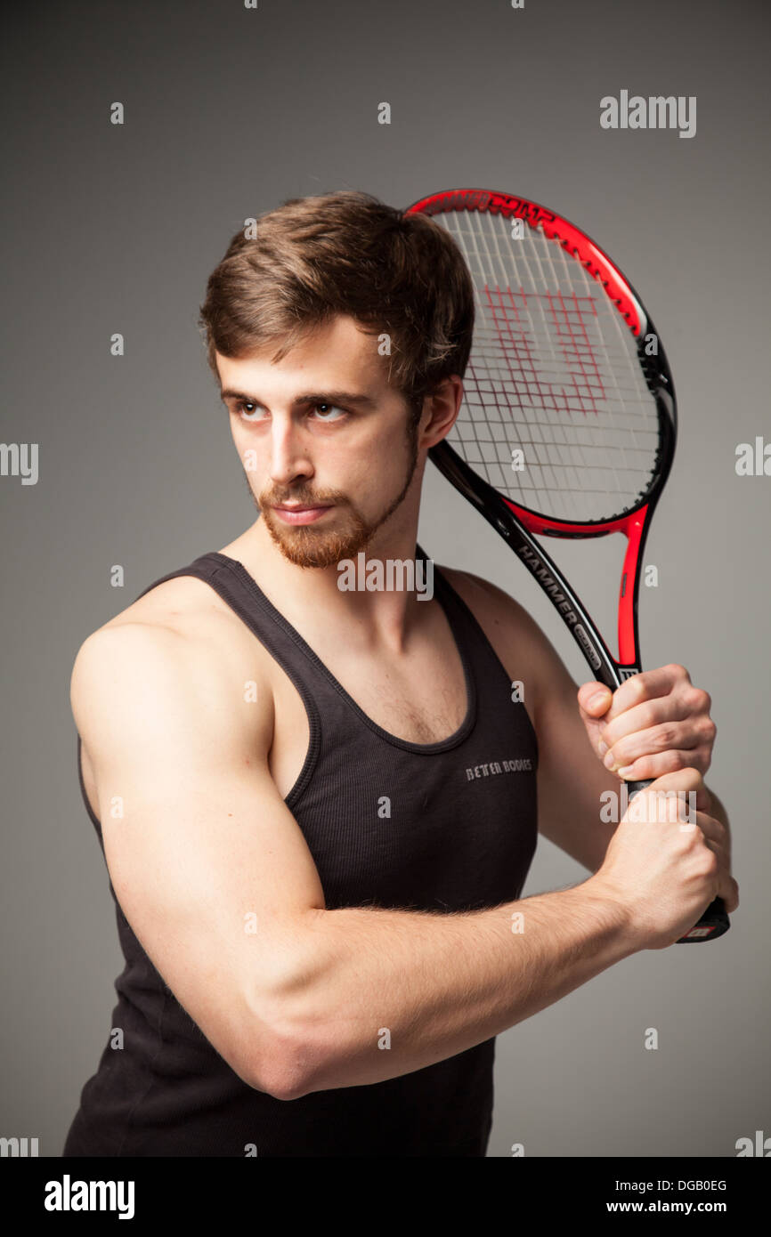 Fit male tennis player model - Stock Image