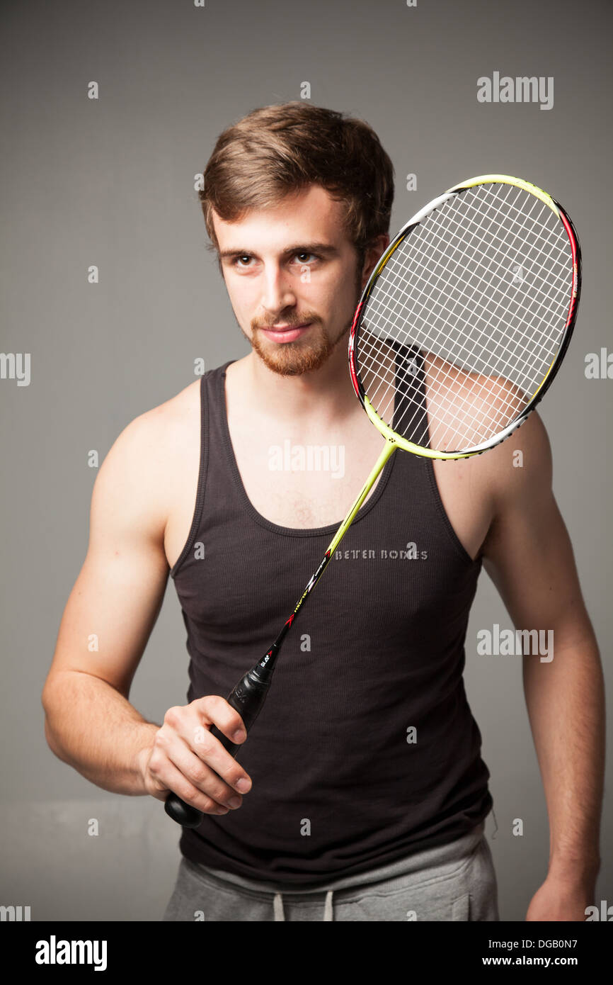 Fit male badminton player model - Stock Image