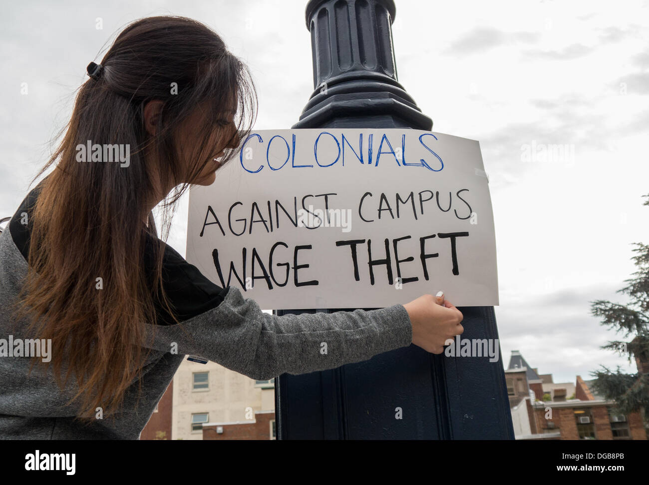 George Washington University students, workers and employees protest alleged wage theft by private contractors on their campus. Protesters marched on campus and delivered a list of demands to university administrators. Credit:  Ann Little/Alamy Live News - Stock Image