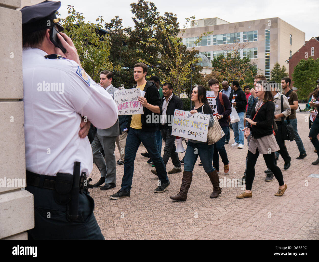Washington DC, USA . 17th Oct, 2013.  George Washington University students, workers and employees protest alleged wage theft by private contractors on their campus. Protesters marched on campus and delivered a list of demands to university administrators. Credit:  Ann Little/Alamy Live News - Stock Image