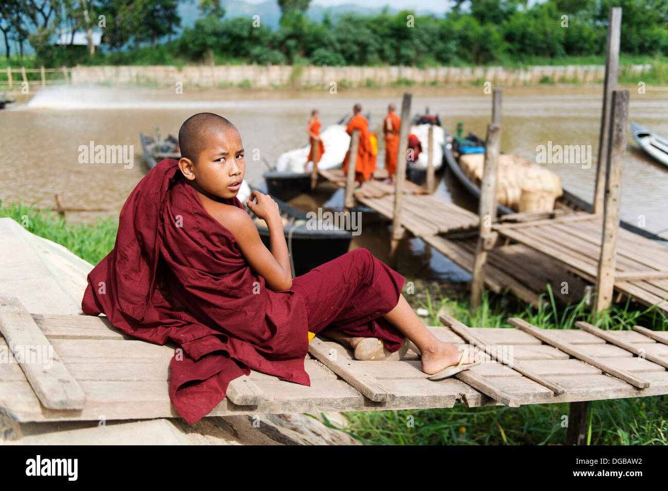 Young monk turns to the camera in Nyaung Shwe. - Stock Image