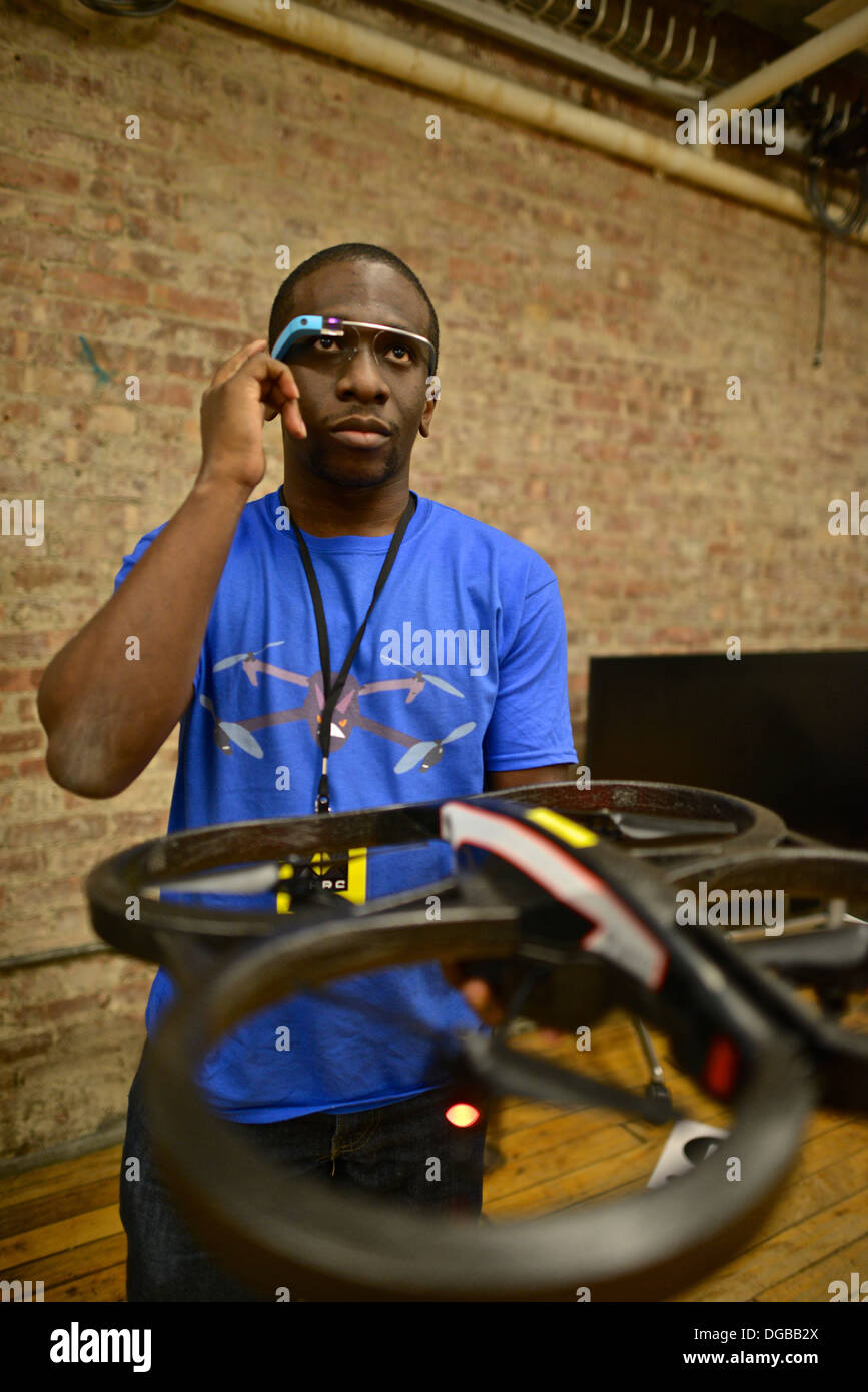 Controlling an AR Drone toy drone using Google glasses at a Nodecopter, an event - Stock Image