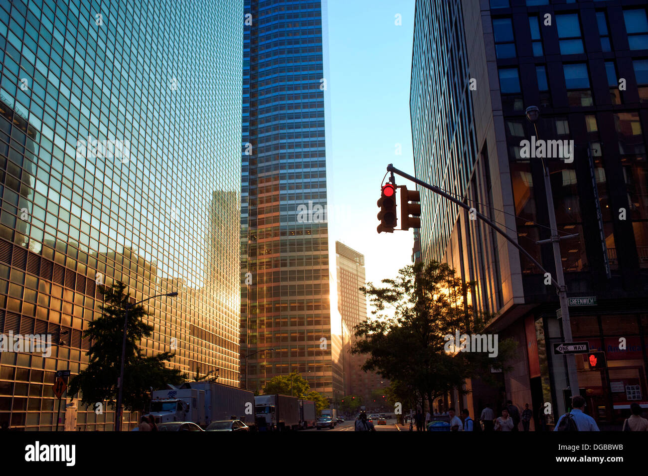sunset reflecting off of glass buildings in lower manhattan new