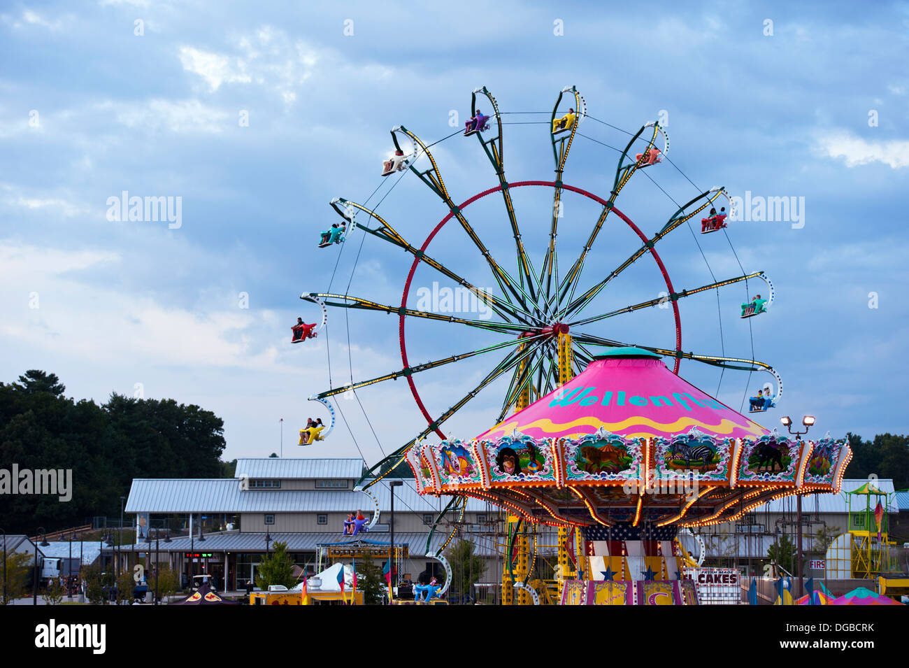 A carnival ride / Farris Wheel in action at the Mountain State Fair in Asheville, North Carolina - Stock Image
