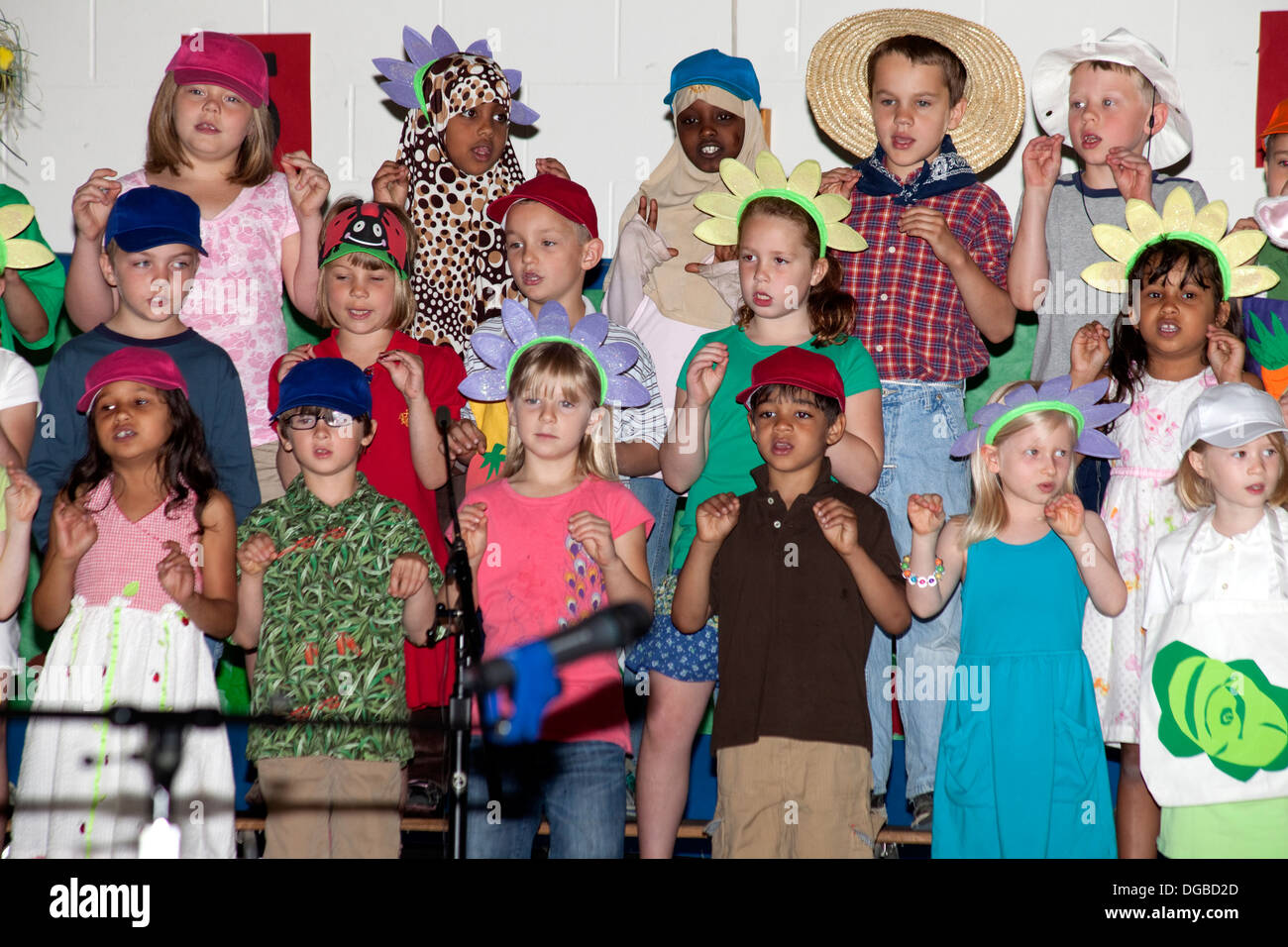 Students age 8 Muslim, Black and white singing in Spring Garden Musical. Horace Mann Elementary School St Paul Minnesota MN USA - Stock Image