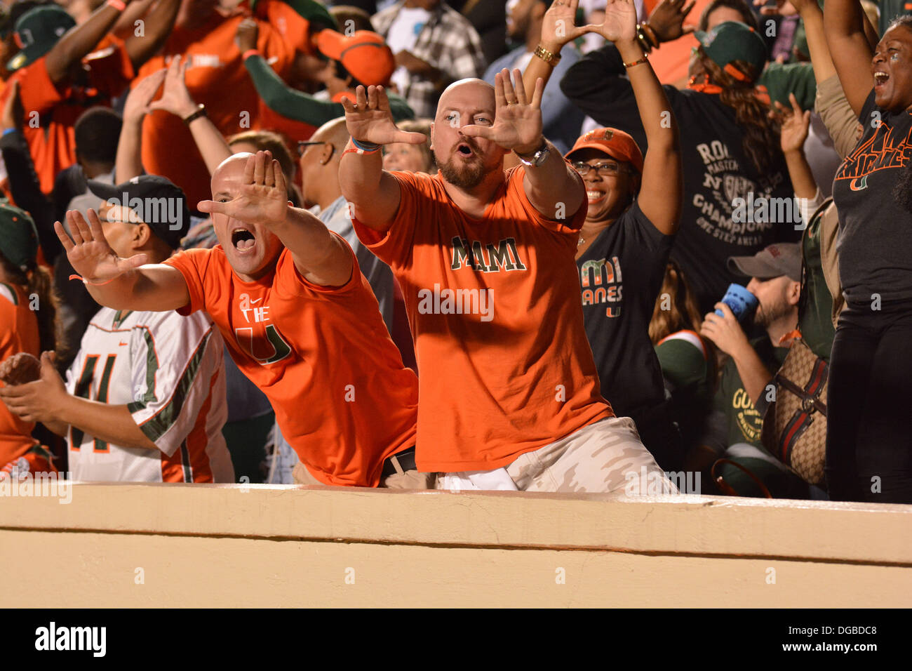 Chapel Hill, NC, USA. 17th Oct, 2013. October 17, 2013: Fans of the Miami Hurricanes cheer during the NCAA Football Stock Photo