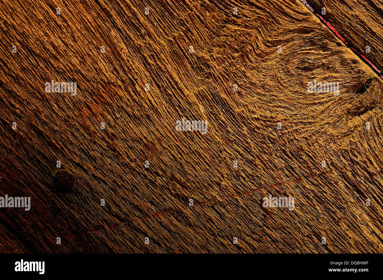 Old wooden surface and nail heads - Stock Image