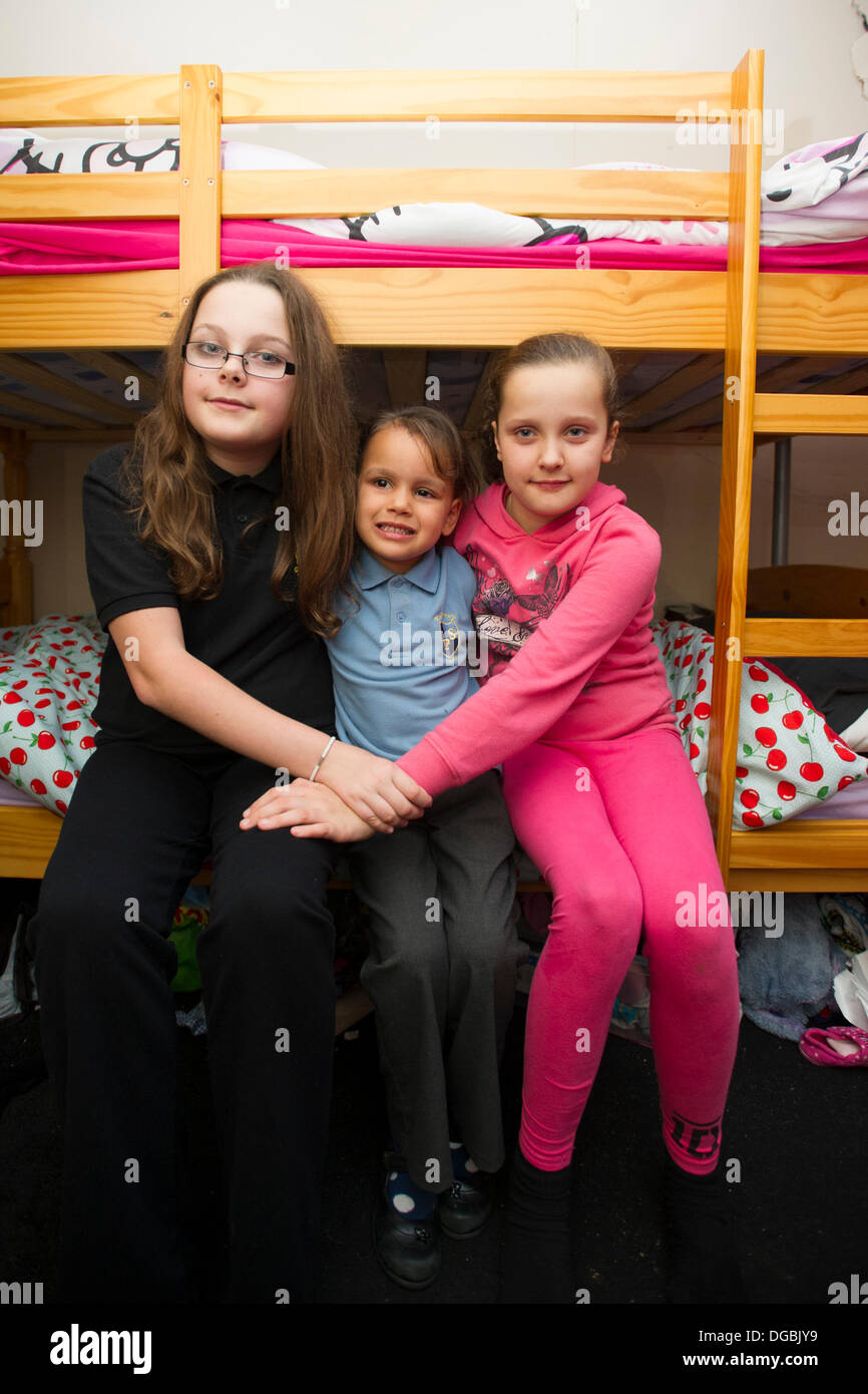Cardiff, Wales, UK . 17th Oct, 2013. The family of Karina Menzies speak about life without her one year after she was killed by hit and run driver Matthew Tvrdon who went on a rampage in his van throughout Cardiff. Picture shows Karina's children (left to right) Sophie, 12, Tiana, 4, and Ellie, 9, who are now all sharing the same bedroom on October 17, 2013 in Cardiff, Wales. Credit:  Matthew Horwood/Alamy Live News - Stock Image