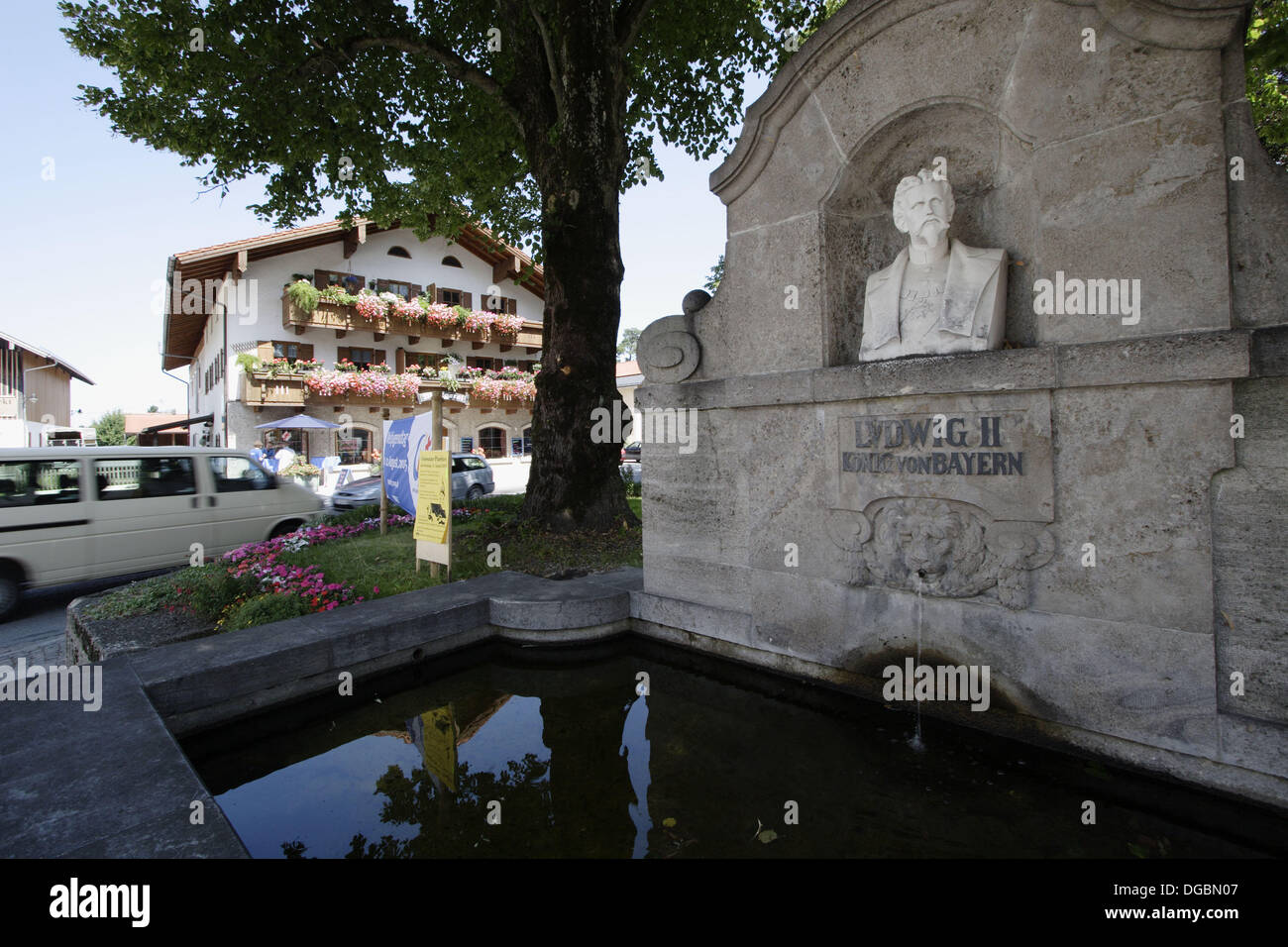 Fountain with bust of King Ludwig II of Bavaria in Grassau, Chiemgau, Upper Bavaria, Bavaria, Germany - Stock Image