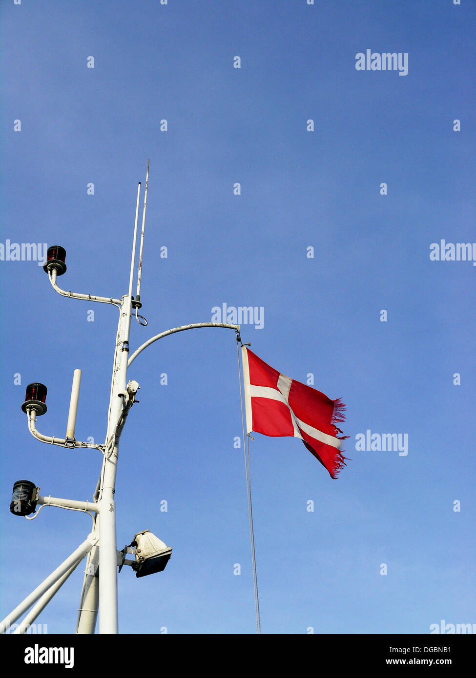The danish flag on ship mast - Stock Image
