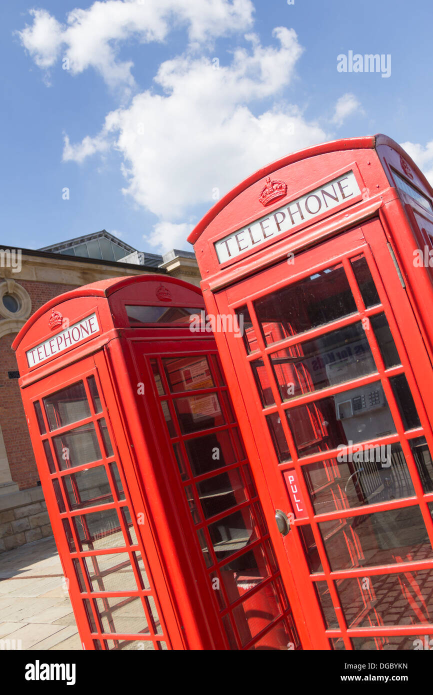 Two old-fashioned red telephone boxes (part of a group of four) outside the Market Place shopping centre, Bolton. (No longer there). - Stock Image