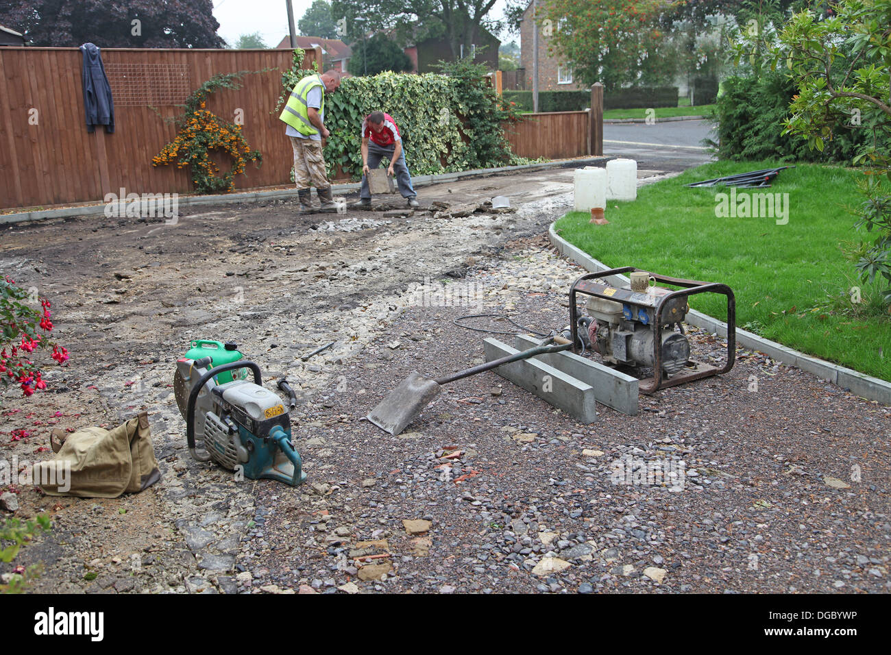 Stage 1 of a project to lay a block paved drive.Preparing base. - Stock Image