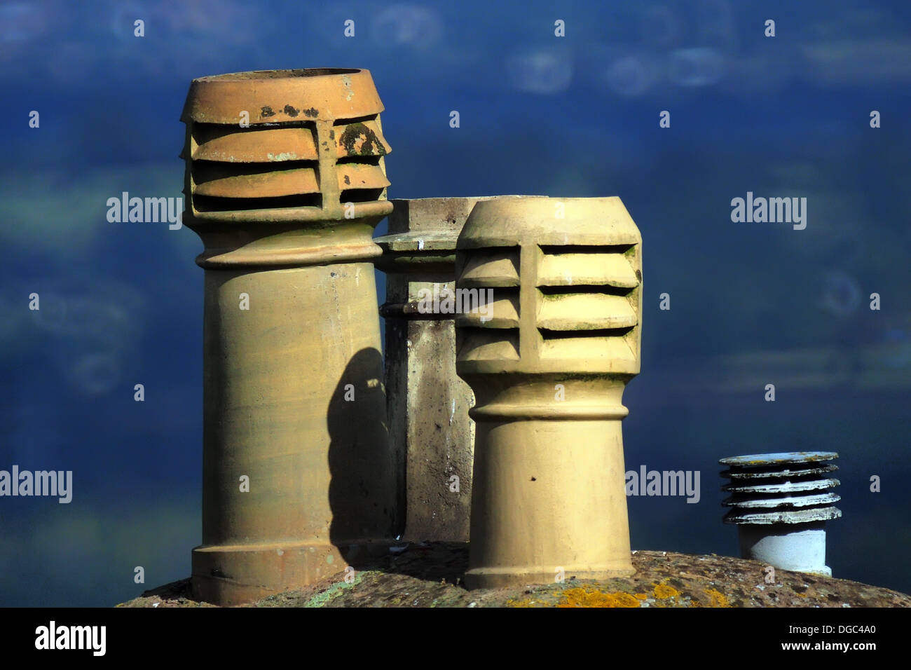 Chimney pots with louvered tops - Stock Image