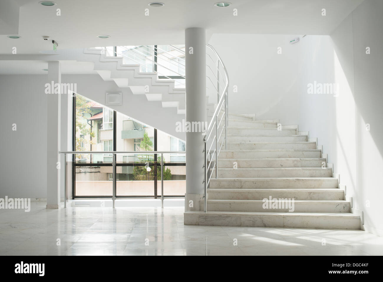 Interior of a building with white color walls. Flight of stairs - Stock Image