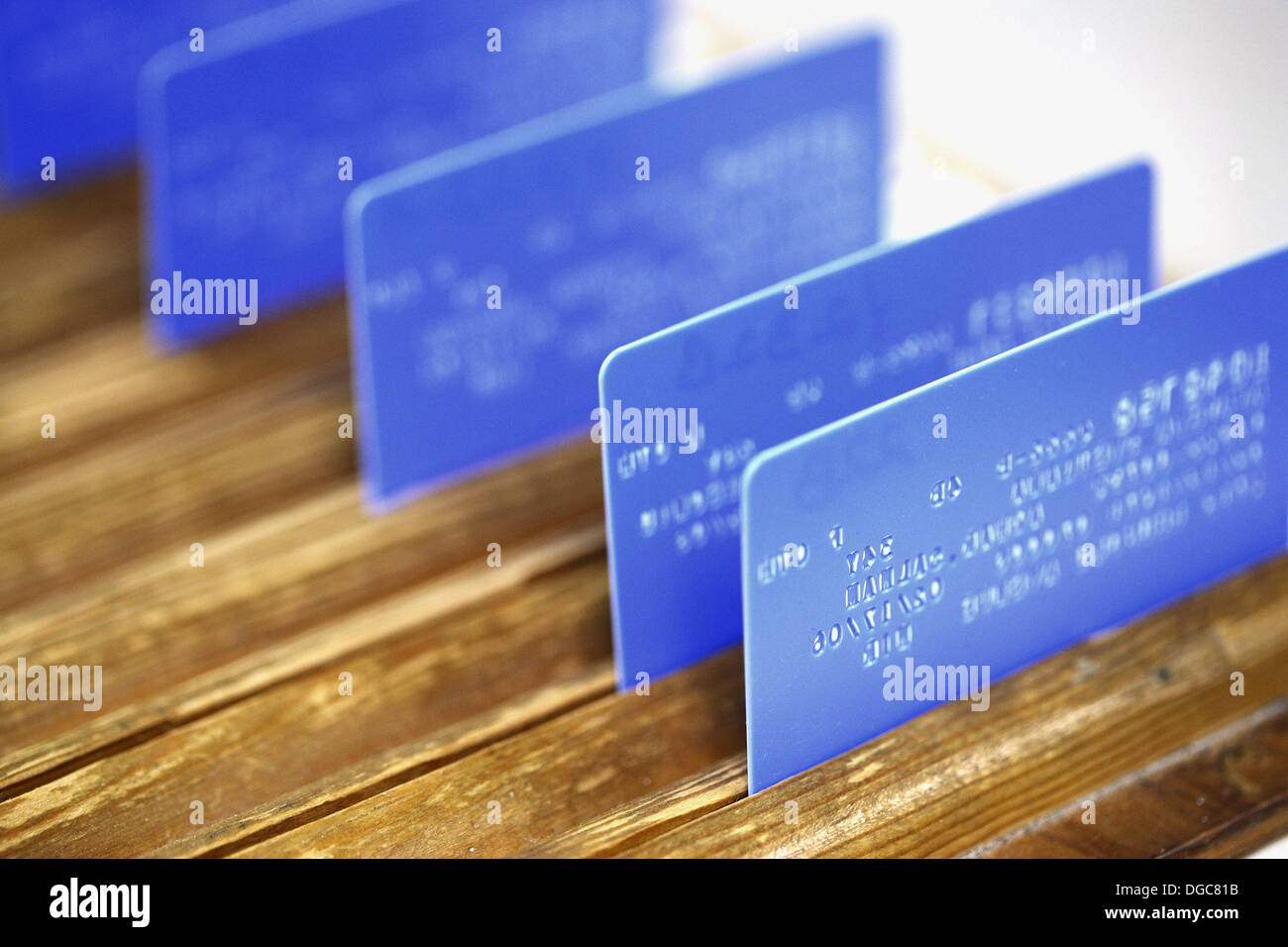 ID cards backwards in rack - Stock Image