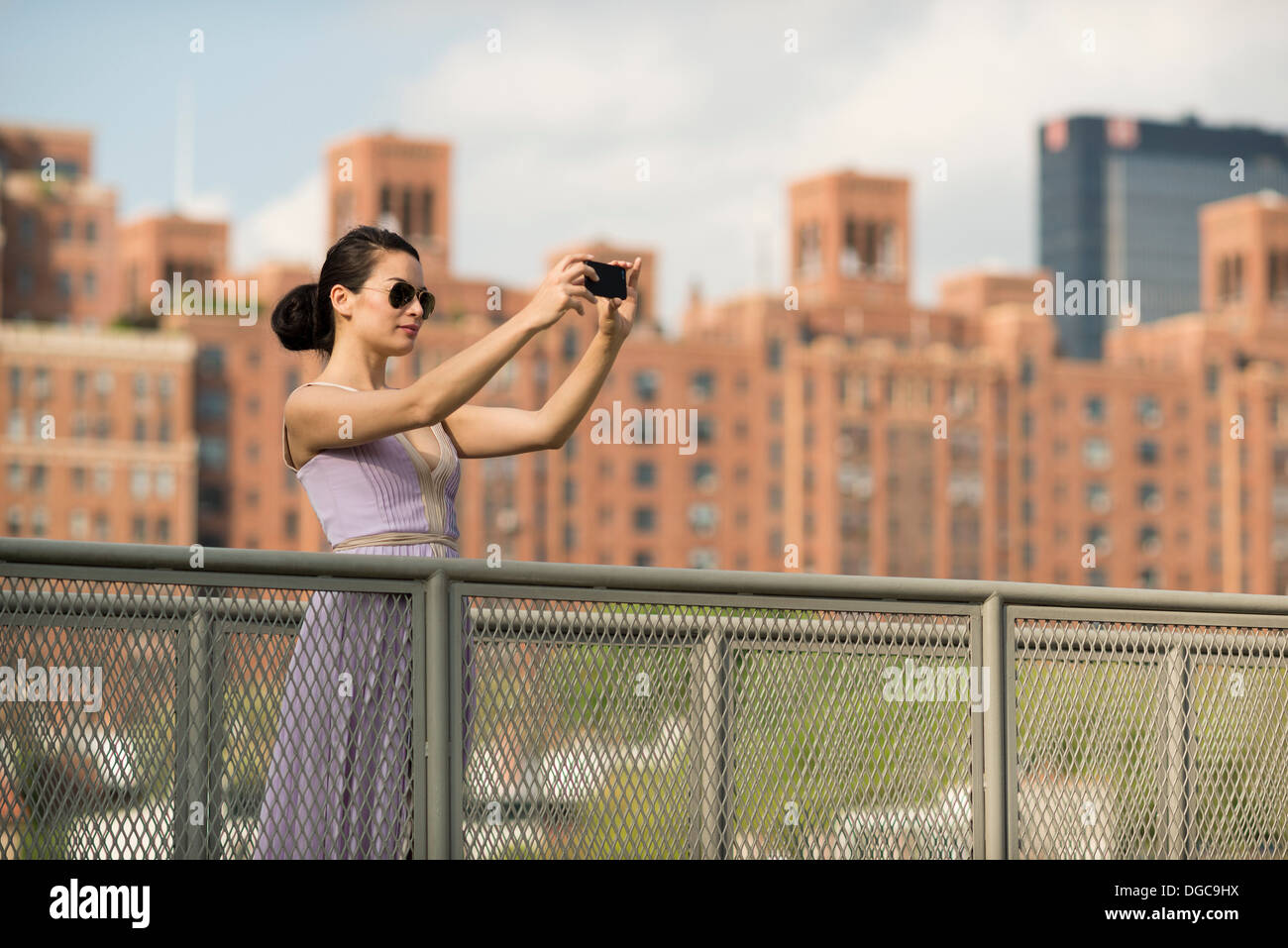 Mid adult women photographing in New York City - Stock Image