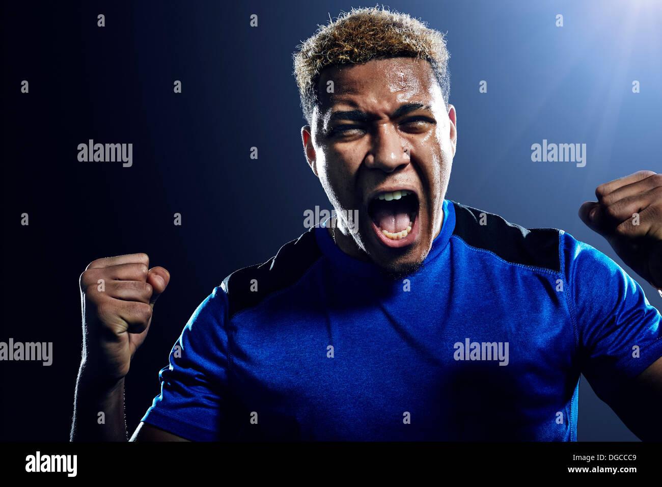 Soccer player celebrating - Stock Image