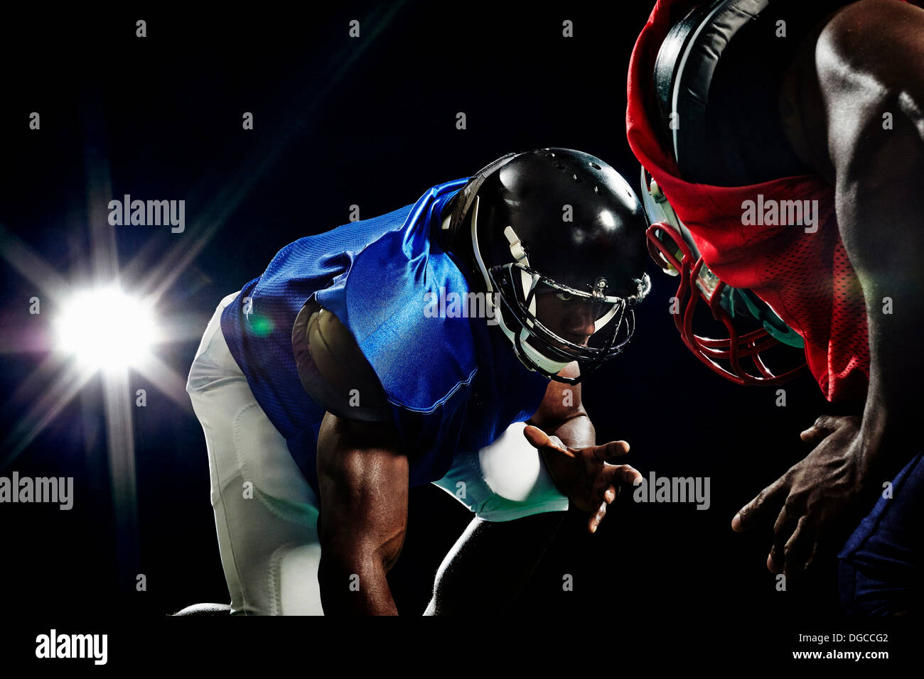 Close up of two american footballers playing head to head - Stock Image