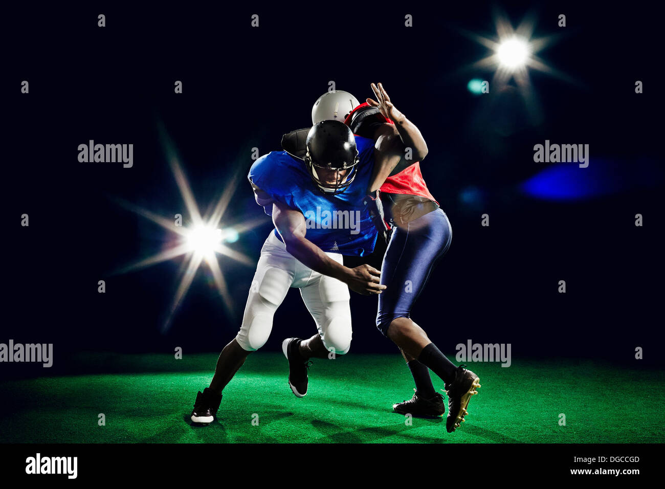 Two american footballers playing - Stock Image