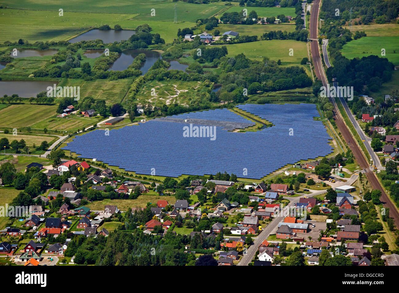 Aerial view over photovoltaic power station / solar park for the supply of merchant power into the electricity grid, Germany - Stock Image