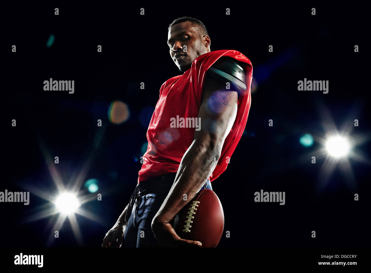 Portrait of american football player - Stock Image