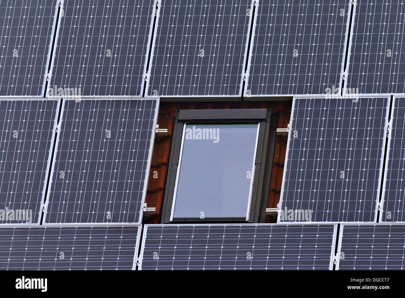 Close-up of photovoltaic solar panels on roof of house for ecological alternative energy - Stock Image