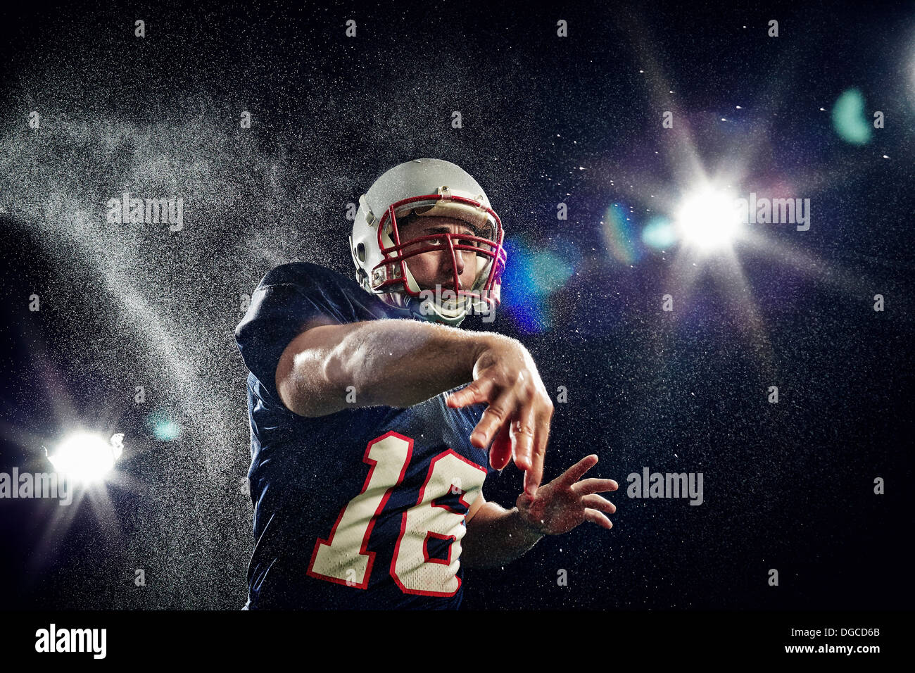 American footballer throwing - Stock Image