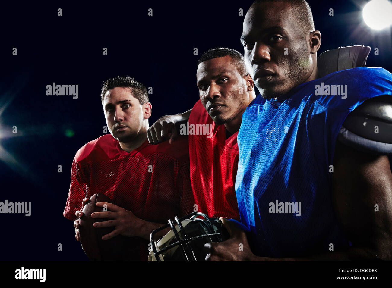 Portrait of three american footballers - Stock Image