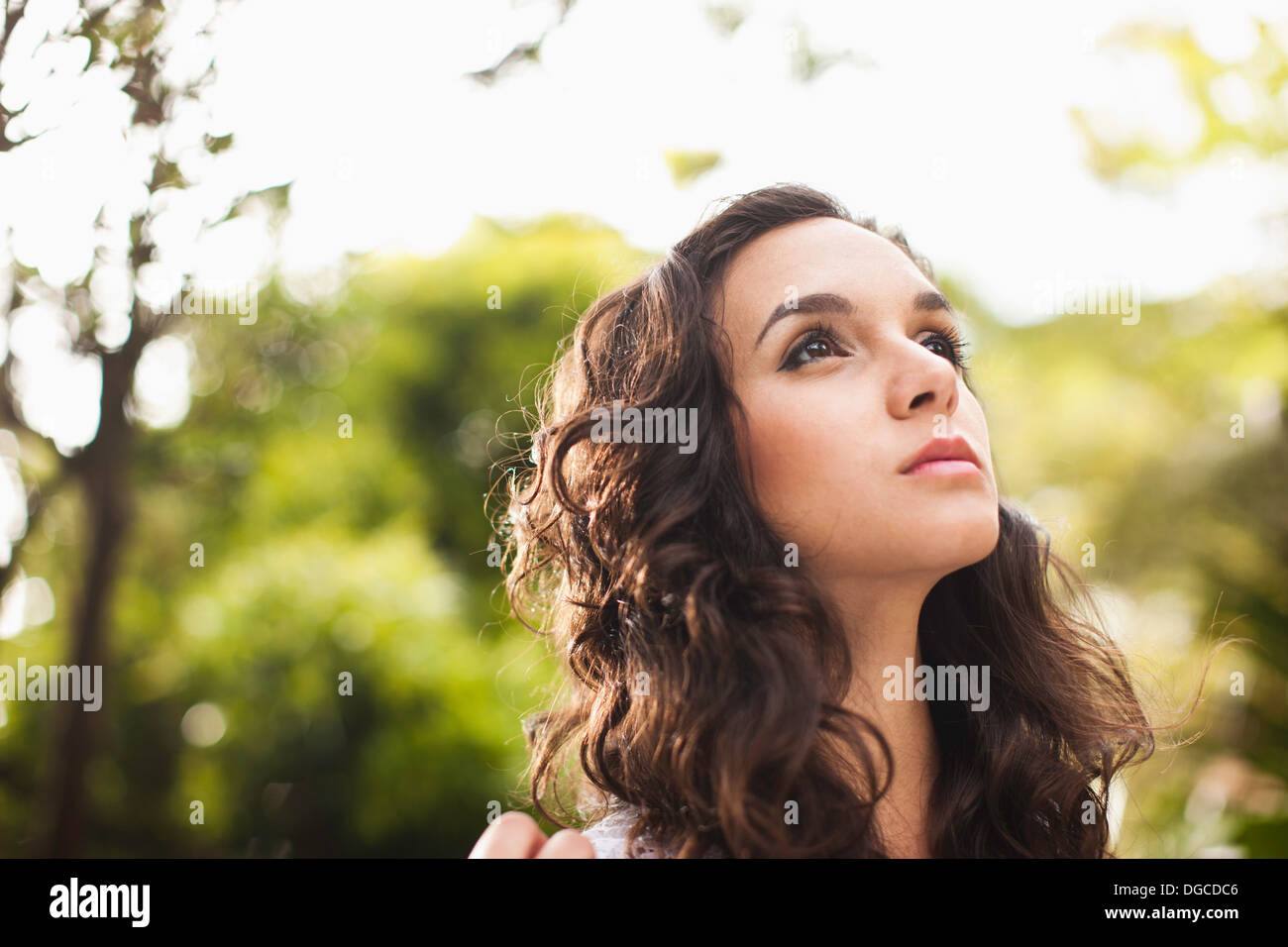 Young woman looking up, close up Stock Photo