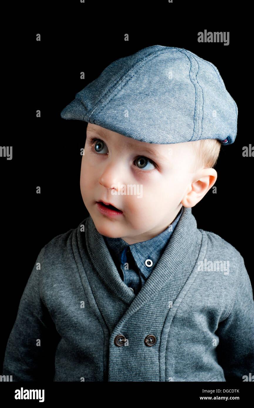 young boy wearing bonnet, looks like a war baby Stock Photo ... c36c3cec33a