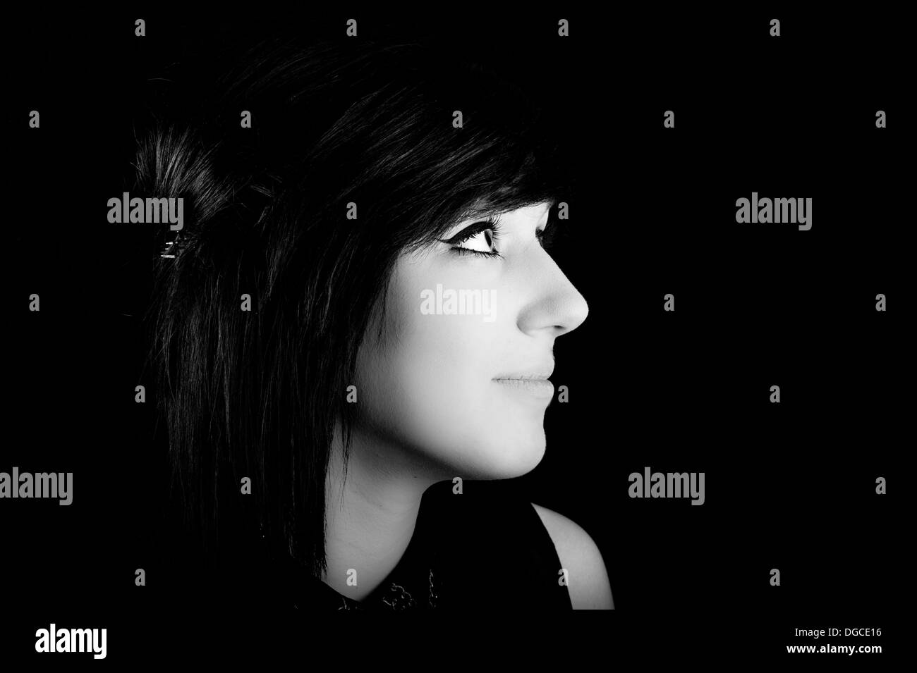 goth girl with cleopatra eyes smiling black and white - Stock Image