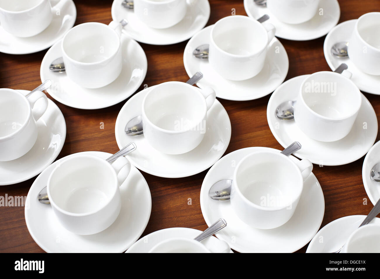 Ordered group of empty cups and saucers Stock Photo