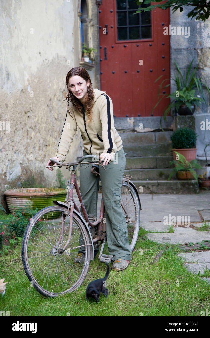 25-30 year old woman with bike - Stock Image
