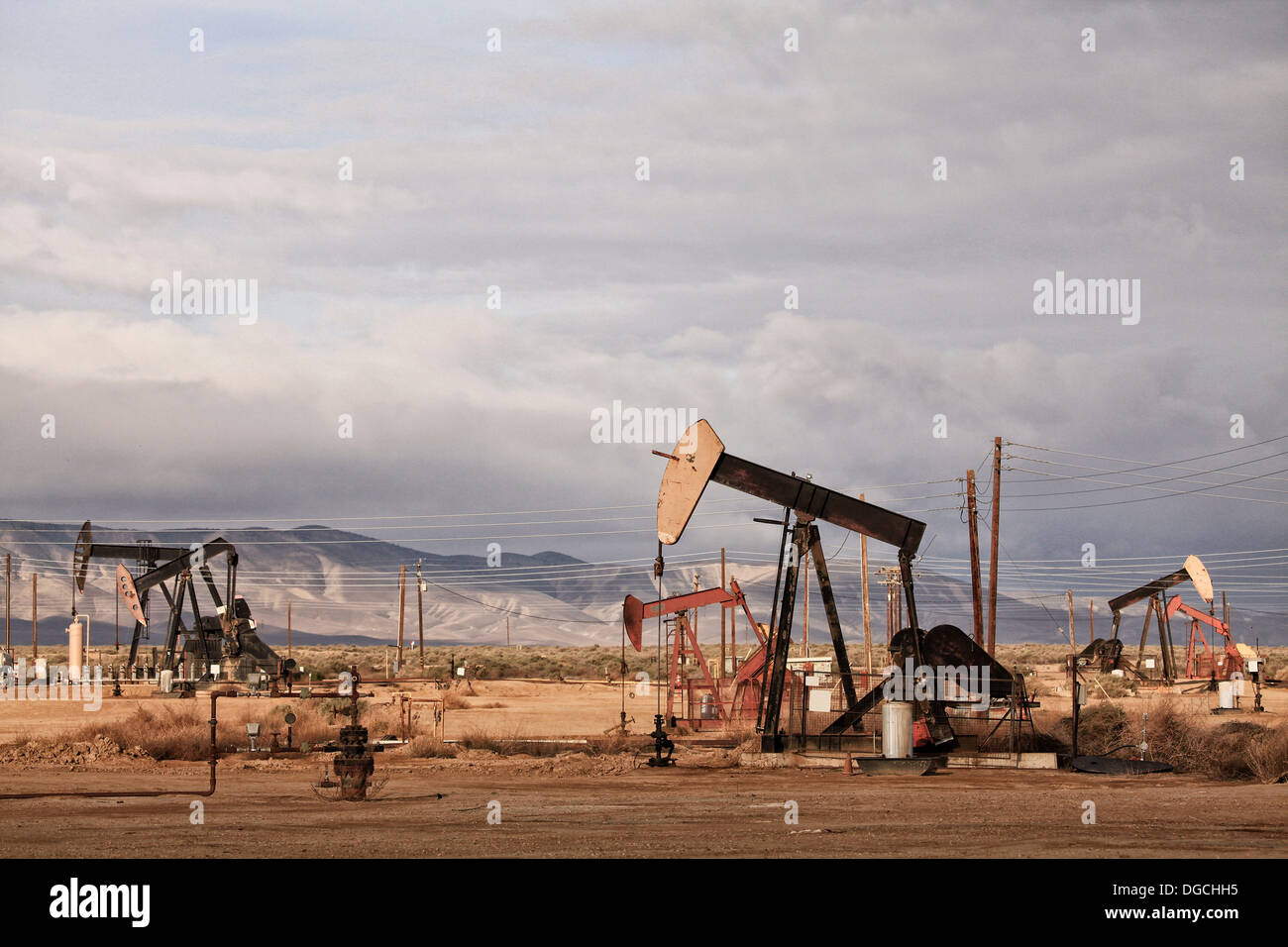 Derricks in oil well, California - Stock Image