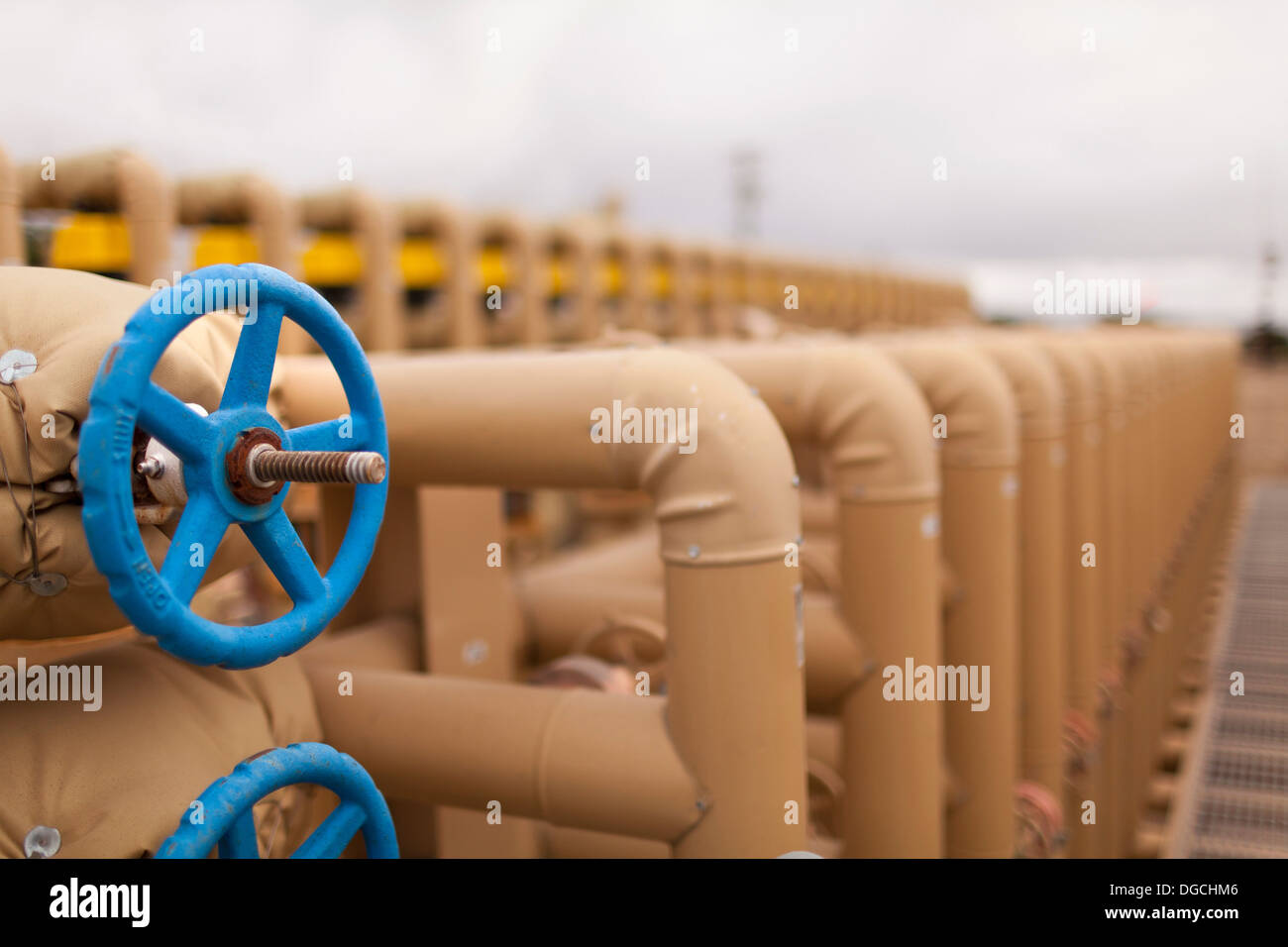 Fuel pipes in oil field, close up - Stock Image