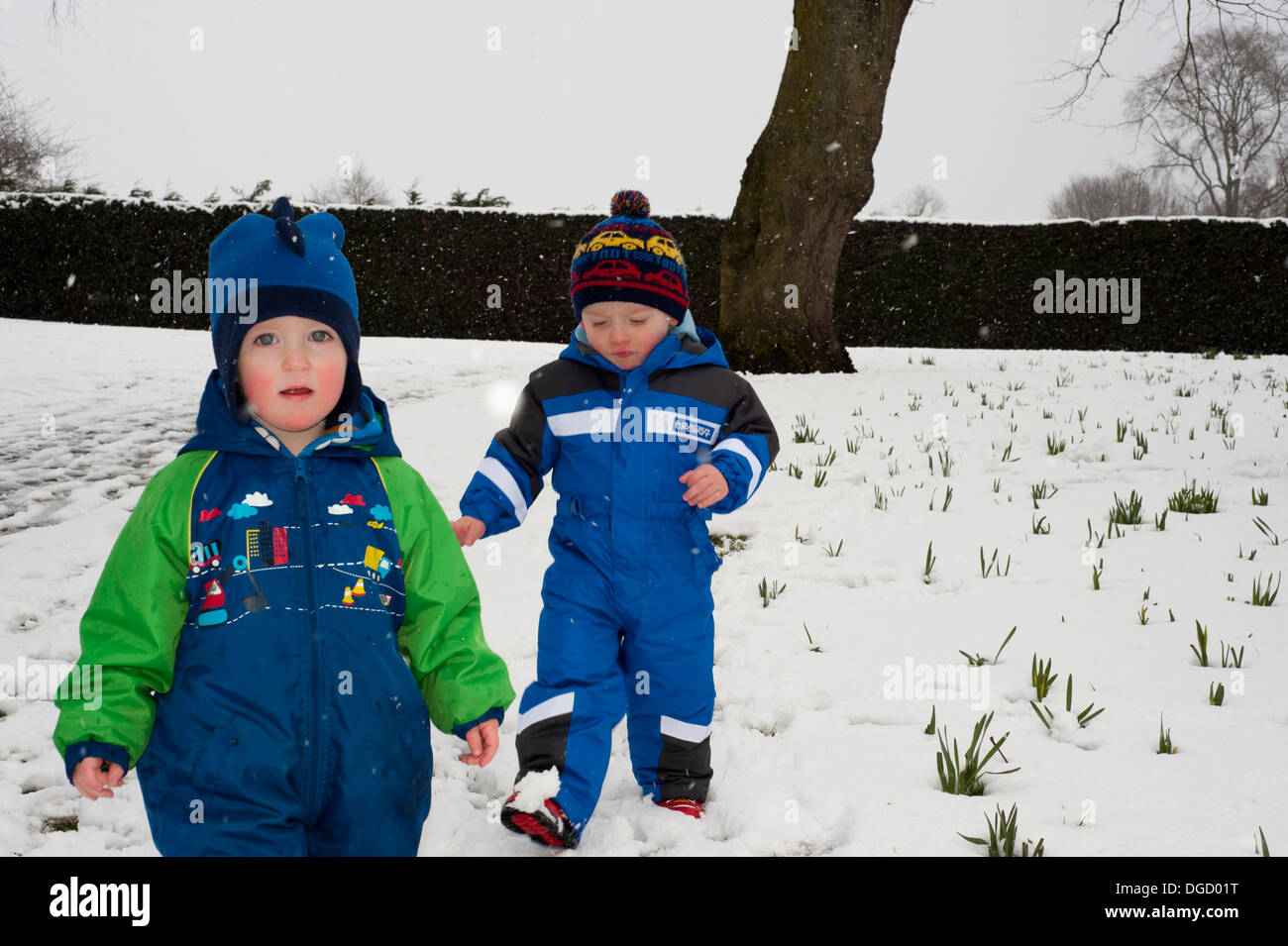 toddlers having fun in blizzard - Stock Image