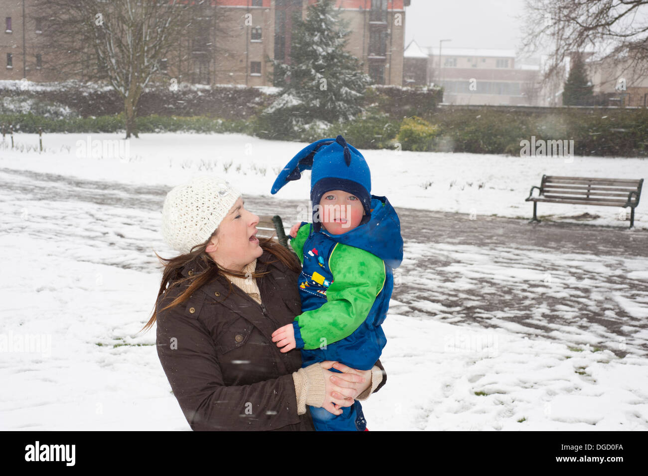 Mum and son in snow blizzard - Stock Image